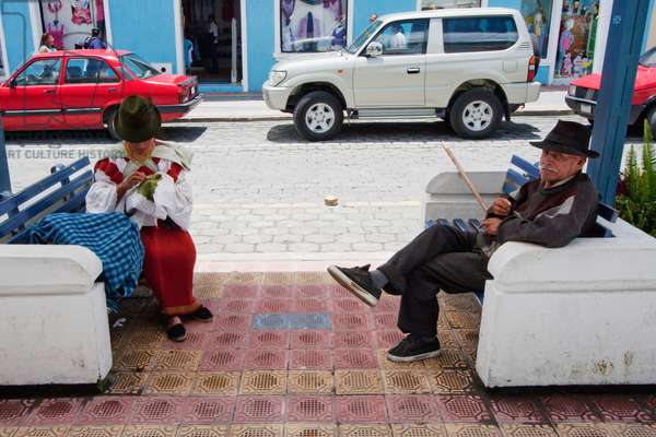 Otavaleno Woman Knitting and Old Man Sitting on Benches, Otavalo, Imbabura, Ecuador (photo)