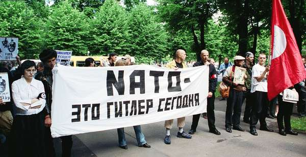 Riga, Latvia, June 17, 2002: the Protestors Hold a Banner Reading 'Nato is the Hitler of Our Time', an Authorized Picket of Latvian National Bolsheviks Protesting Against Latvia'S Joining Nato, Was Held at the Building of the Latvian Government, the Protestors Demanded a Referendum on Joining Nato to Be Held in Latvia.