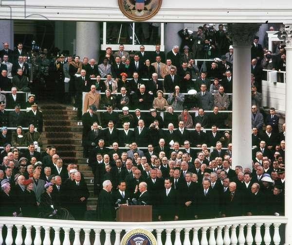 Earl Warren, swearing Dwight Eisenhower into office as President