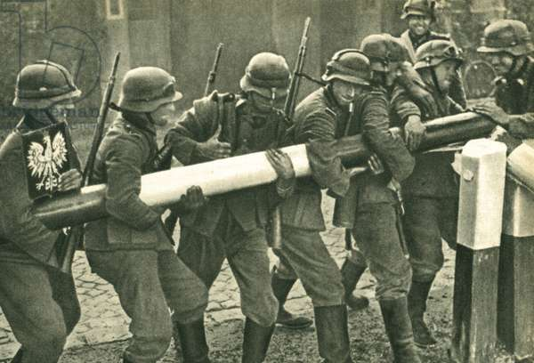 I September 1939, German troops remove the border barrier between Poland and Germany during the invasion of Poland. The Nazi occupation of Poland caused Britain and France to declare war on 3 September 1939 and the formal beginning of the Second World War.