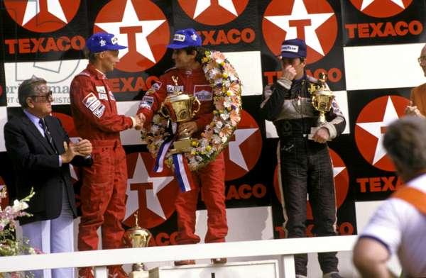 Alain Prost 1st, Niki Lauda 2nd in mclaren mp4-2s on the podium, 1984 (photo)