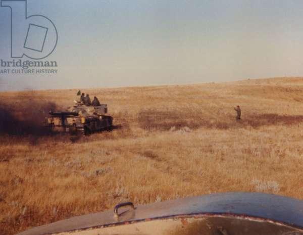 A Tank Driving Through the Falklands, 1982 (photo)