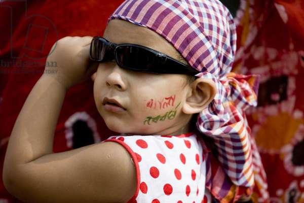 Close up of a child on the rally organized by students of Fine Art Institute of Dhaka University marking Pahela Baishakh (Bangla New Year). Dhaka, Bangladesh. April 14, 2009.  (photo)