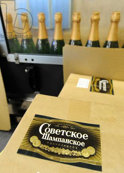 Moscow, Russia, November 29, 2010, Bottles of Sovetskoye Shampanskoye Being Packed in Boxes at Kornet, a Moscow-Based Champagne Winery.