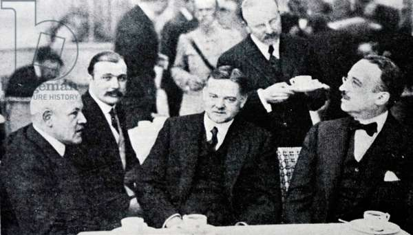 Herbert Hoover dining with French government officials.