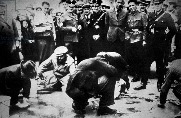 Jews being forced to scrub the streets of Vienna