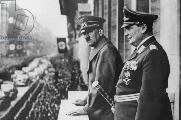 Hermann Goring and Adolf Hitler review a parade in Prussia 1938