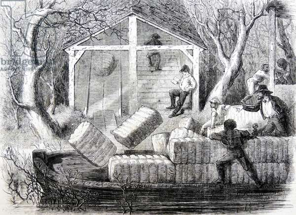 Cotton bales being loaded onto a boat
