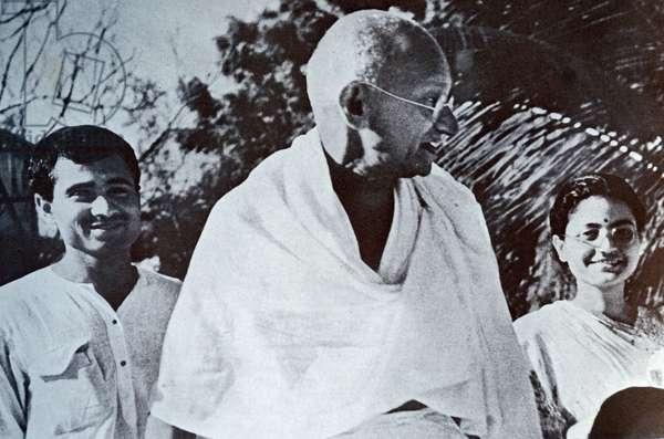 Mohandas Karamchand Gandhi with Kanu and Abar Gandhi