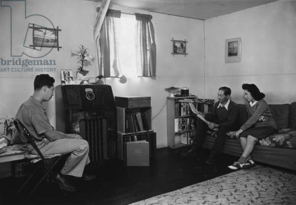 Members of the Yonemitsu family in their living room, Manzanar Relocation Center, California, 1943 (photo)
