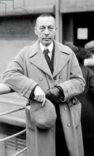 Sergei Vasilievich Rachmaninoff  (1873-1943) Russian composer, pianist and conductor. After 1917 Revolution he left Russia and settled in America in 1918. Three-quarter image in overcoat, hat in hand, looking at camera. Music