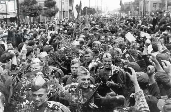 The Inhabitants of Pkenyan Bid a Fond Farewell to the Soviet Army Who, in Accordance with the Agreement of the Soviet Government, are Leaving Exactly on the Date Promised.