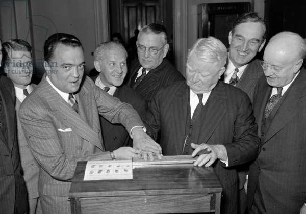 19390101, J. Edgar Hoover fingerprinting Vice President John N. Garner. J. Edgar. Hoover 1895-1972. Director of the FBI (Federal Bureau of Investigation), from 1924-1972.
