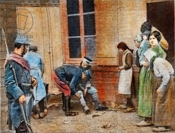 The german prisoner receving first-aid from a French Red Cross officer was an object of interest to the French people in the farm behind the lines to which he had been taken