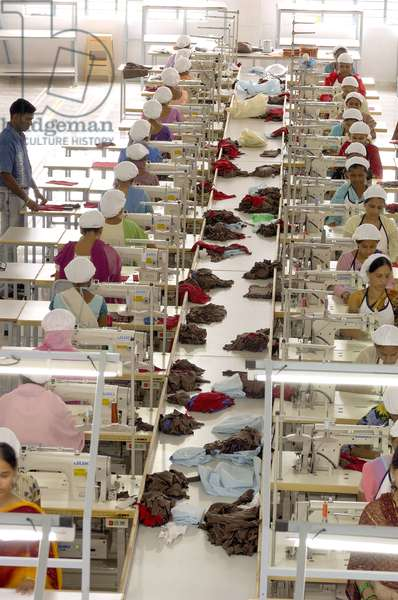 Readymade Garment Factory Interior People Working On Sewing Machine Suditi Industries At Bombay Mumbai, Maharashtra, India
