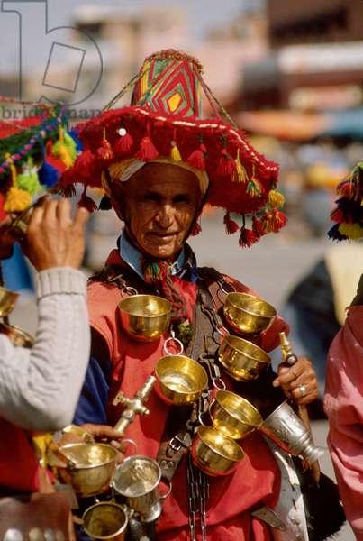 Morocco, Marrakesh.   Water Vendor