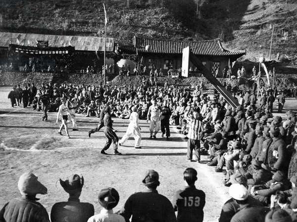 Korean War. A basketball game between Camps 1 and 2 in the POW's Inter-camp Olympics sponsored by the Chinese People's Volunteers and the Korean People's Army. These games were held from November 15 through the 26th in 1952 somewhere in Korea.