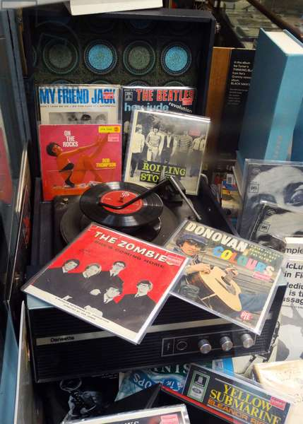 Dansette record player circa 1968 with vinyl records, from the sixties pop music era