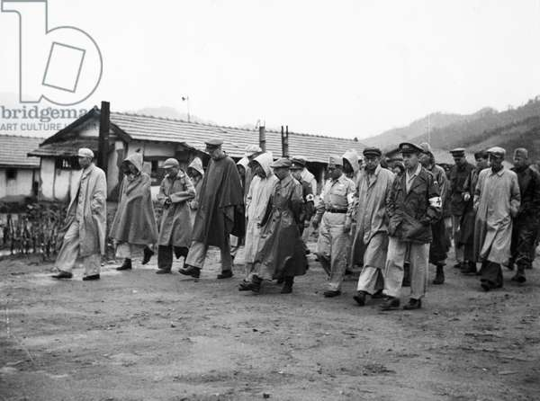 Korean War. Representatives of the joint Red Cross team visiting the prisoners' living quarters at the No. 1 POW camp. October 1953.
