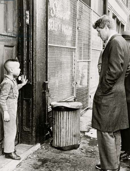 Senator Robert] Kennedy discusses school with young Ricky Taggart of 733 Gates Ave. 1966 (photo)