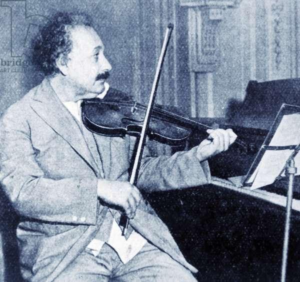 Professor Albert Einstein playing his violin.