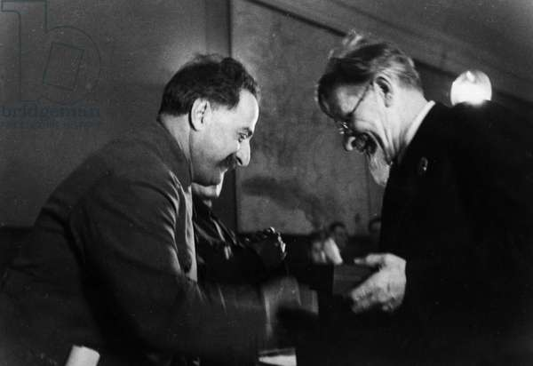 M, I, Kalinin, President of the Central Executive Committee of the USSR, Awarding the Order of the Red Banner of Labor to Grigoriy Konstantinovich Ordzhonikidze (Sergo Ordzhonikidze), the People'S Commissar of Heavy Industry, for Over-Fulfilling the Production Plan of 1935.