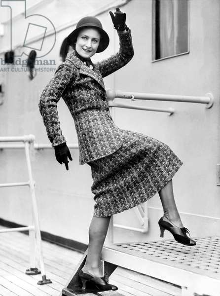 A Lively Woman Boards A Ship (b/w photo)