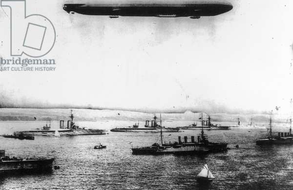 A Zeppelin Flying over Captured Ships, 1916 (b/w photo)