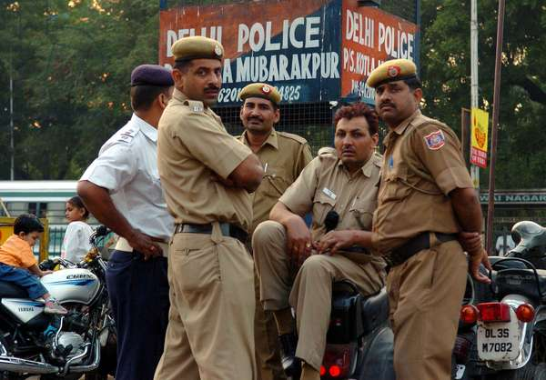 Indian policemen take a break as the patrol a street of New Delhi, capital of India Nov 1, 2005