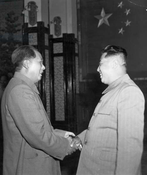 Chairman Mao Zedong shaking hands with Marshal Kim Il Sung as he receives the government delegation of the Democratic People's Republic of Korea. October 1954