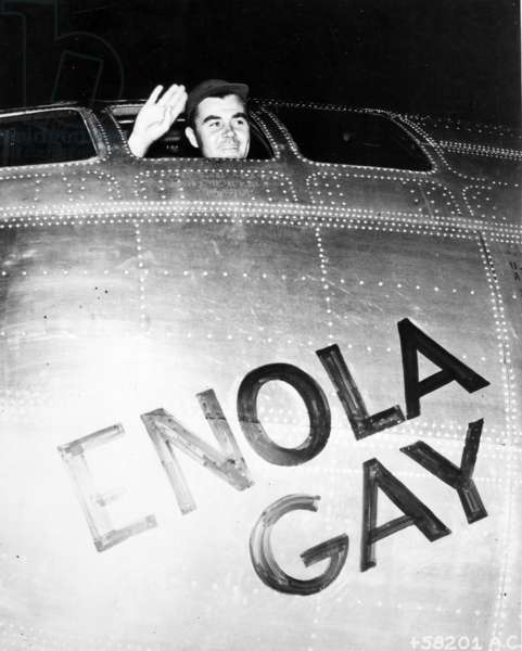Colonel Paul Tibbets waving from the Enola Gay's cockpit, 1945