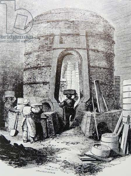 Filling a kiln ready for firing, Copeland's factory, Stoke on Trent, (The Potteries), Staffordshire, England. Engraving, London, c1860.