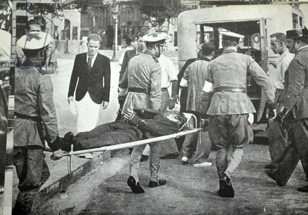 Casualty from street fighting arrives at a Barcelona hospital during the Spanish civil war 1938