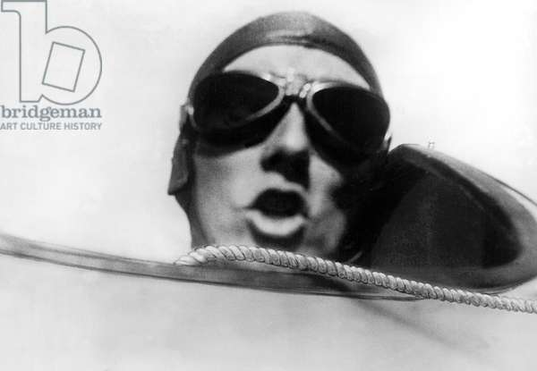 Germany: May 24, 1931 Willi Ruge is endeavoring to take the first sky diving self portraits as he leaps from a plane with a parachute. Here is his photograph of the pilot as he gives the command, 'Go' to Willi Ruge to let go of the hand rope and dive head first into space, 'gasping a prayer to heaven'.  (b/w photo)