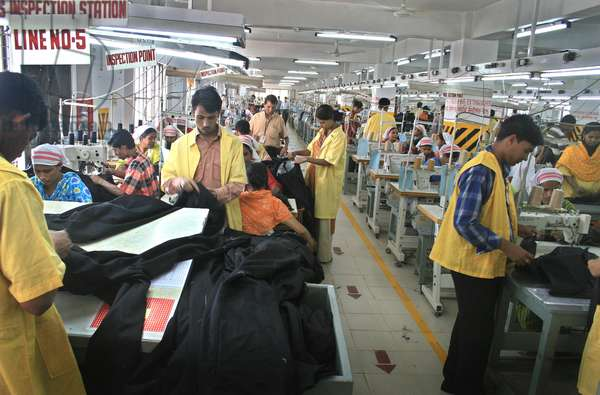 An inside view of a readymade garment factory in Dhaka. Bangladesh earns 80% of total export from RMG sector. Thousands of garments are situated in capital city and more than 1.5 million young women earn a living by stitching garments in these factories. During 2001-2002, export earnings from ready-made garments reached ,125 million. Dhaka, Bangladesh. November 19, 2007.  (photo)