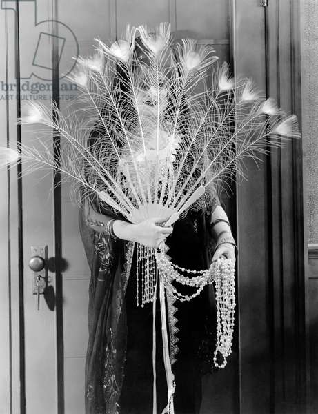 Peacock Feather Peeking, Hollywood, California, 1921 (b/w photo)