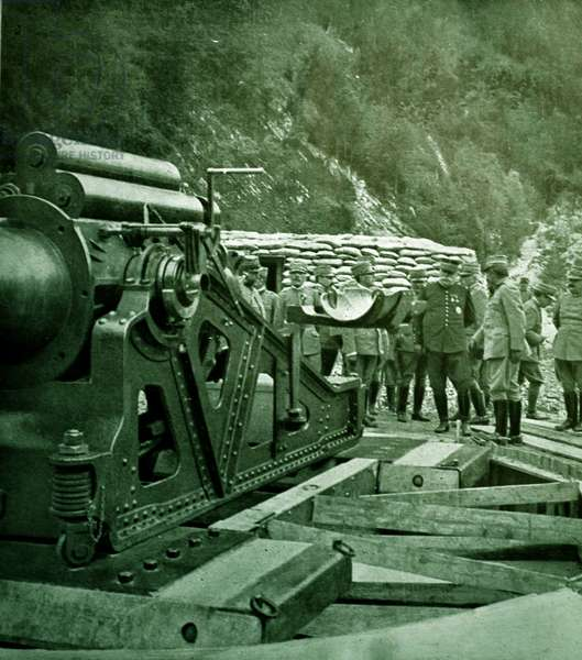 During his visit to the front, General Joffre reviews an artillery position