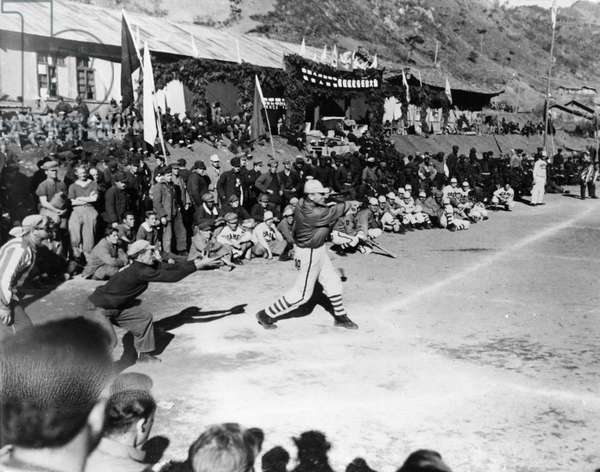 Korean War. A baseball game between Camps 1 and 2 in the POW's Inter-camp Olympics sponsored by the Chinese People's Volunteers and the Korean People's Army. These games were held from November 15 through the 26th in 1952 somewhere in Korea. William C. Watson is at bat and Bernard L. Wheeler is catching. ©Sovfoto/UIG/Leemage