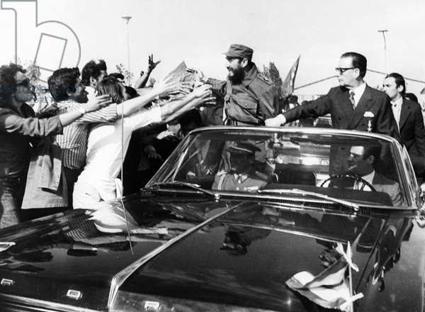 Fidel Castro of Cuba with President Salvador Allende Being Greeted by Chilean Students Upon his Arrival at Pudahuel Airport in Santiago on November 10, 1971.