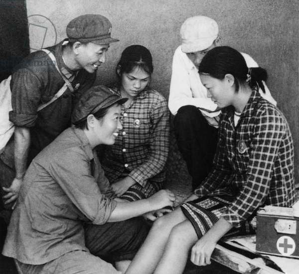 A medical team (Barefoot Doctors) performing acupuncture, China, 1968