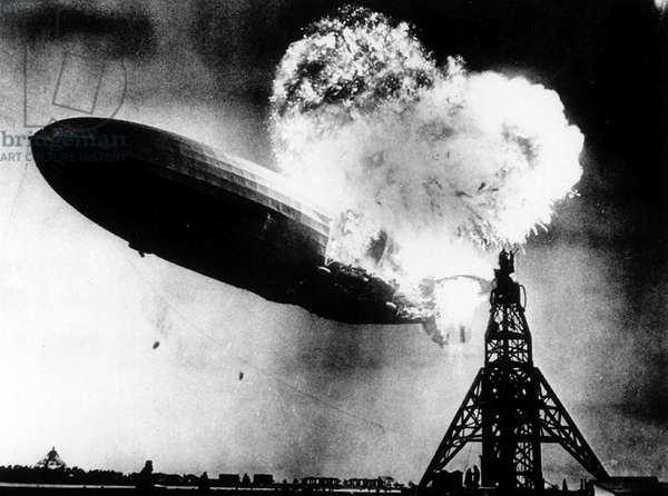 The Hindenburg, a large German commercial passenger-carrying rigid airship, destroyed by fire