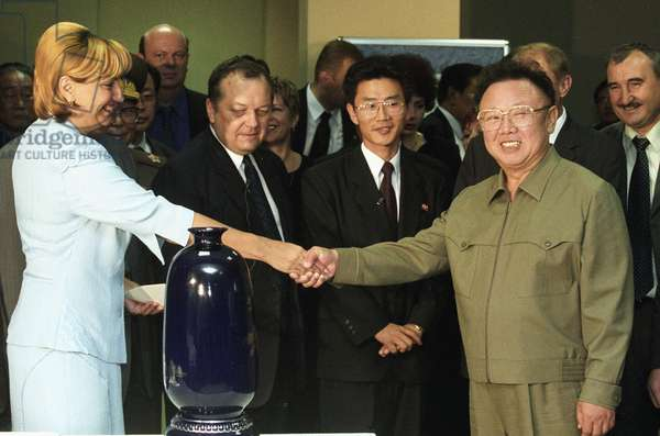 Visiting North Korean Leader Kim Jong-Il (R) Shakes Hands with Director of the Trade Complex 'Ignat' Yelena Kalinina (L) at the Complex in Vladivostok on Friday, the Honourable Gueat Presented a Traditional Korean Vase (Foreground) to the Administration of 'Ignat, ' 8/23/02.