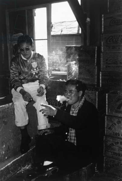 Two young men in co-op goods store, Manzanar Relocation Center, California, 1943 (photo)