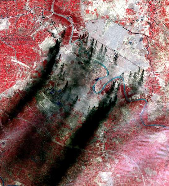 Smoke plumes above Baghdad Iraq, which originate along major roads and canals, believed to be burning pools of oil from pipelines. Taken by NASA during the 2003 Invasion of Iraq. Science Earth Geology War Pollution