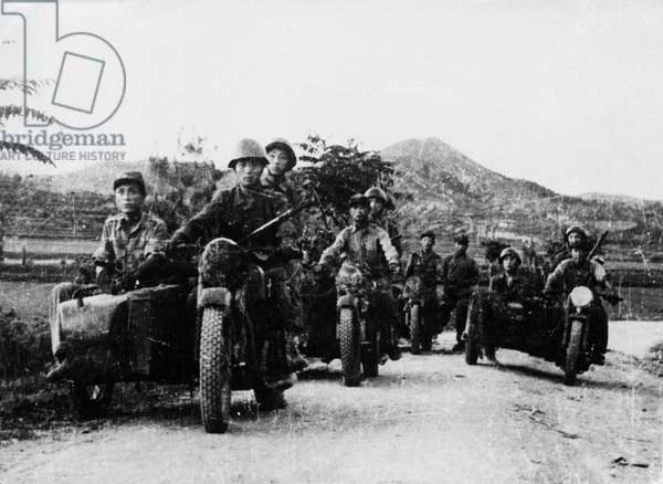 Korean War. Motorcycle troops of the Korean People's Army heading for the front