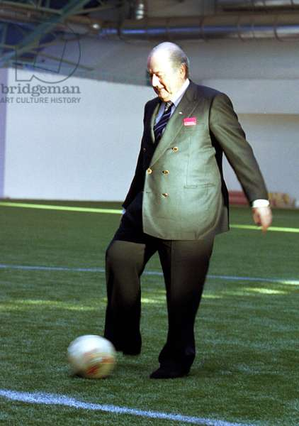 Minsk, Belarus, December 8 2002: Fifa President Joseph Blatter Kicks a Football (In Pic) at a Ceremony Held on Sunday to Celebrate the Opening of a Football Field with Artificial Covering, the Field Was Created Under the Aegis of 'Goal' Programme Financed by Fifa, (Photo Viktor Tolochko).