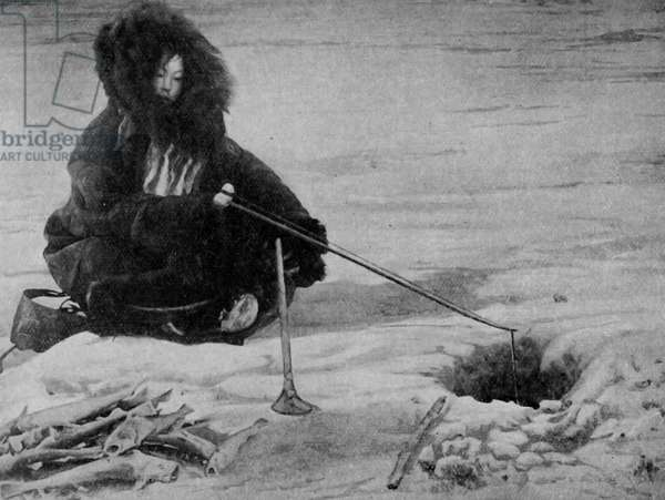 North America. Native woman of Artic Alaska fishing. 1920
