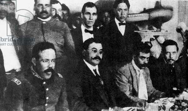 Seated, from left to right, Doroteo Arango Arambula (1878-1923) known as Pancho Villa, Mexican revolutionary general, Eulalio Gutierrez (1881-1939) Mexican politician, President of Mexico 1914-1915, Emiliano Zapata (1879-1919) Mexican Revolutionary leader, and Felicitas Villareal. 1914 .