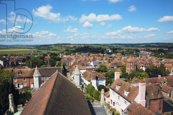 Great Britain, England, East Sussex, Rye, blue sky above rooftops of historic town and verdant countryside