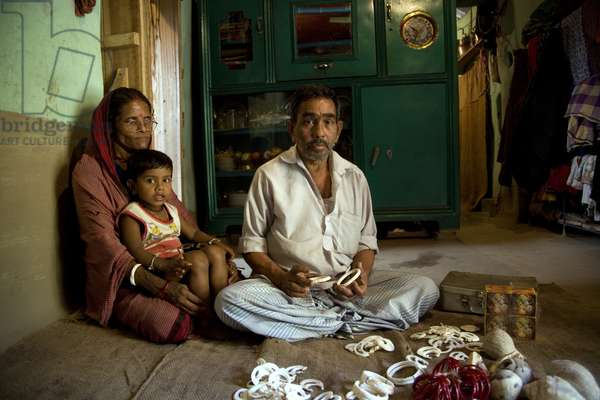 Moni Rani, and her husband Dulal Chandra Dhar, run a workshop of conch ornaments, locally known as Shakha. They have married off their two daughters and their only son helps them in the business. They have been with Grameen Bank for 20 years. They took two loans; Taka 60,000 and Taka 80,000. They have seven craftsmen or Karigar. The conch comes from Sri Lanka. They supply the ornaments to Shakhari Bazaar in Dhaka and other districts like Tangail, Pabna, and Rangpur. Nayapur, Narayanganj, Bangladesh. January 28, 2007.  (photo)